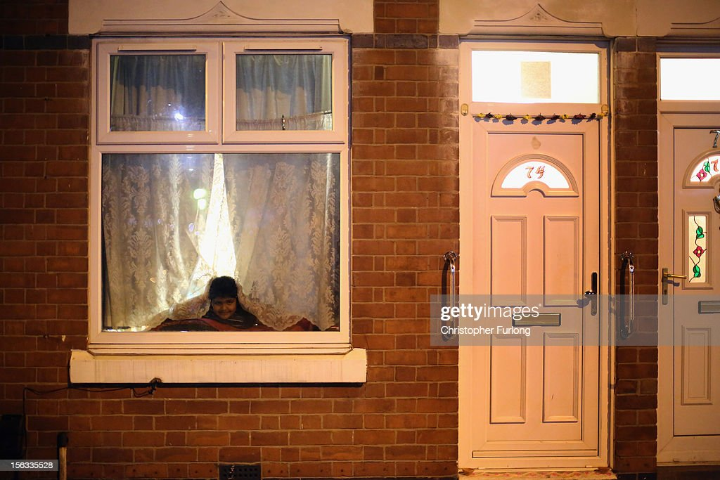 A young boy looks out from his home to watch fireworks during the Hindu festival of Diwali on November 13, 2012 in Leicester, United Kingdom. Up to 35,000 people attended the Diwali festival of light in Leicester's Golden Mile in the heart of the city's asian community. The festival is an opportunity for Hindus to honour Lakshmi, the goddess of wealth and other gods. Leicester's celebrations are one of the biggest in the world outside India. Sikhs and Jains also celebrate Diwali.