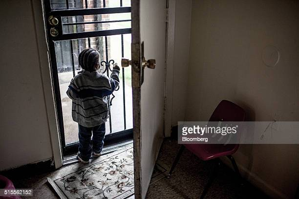 A young boy looks out the door of a home at the Warren Apartments in Memphis Tennessee US on Friday March 11 2016 Conditions at the Warren and Tulane...