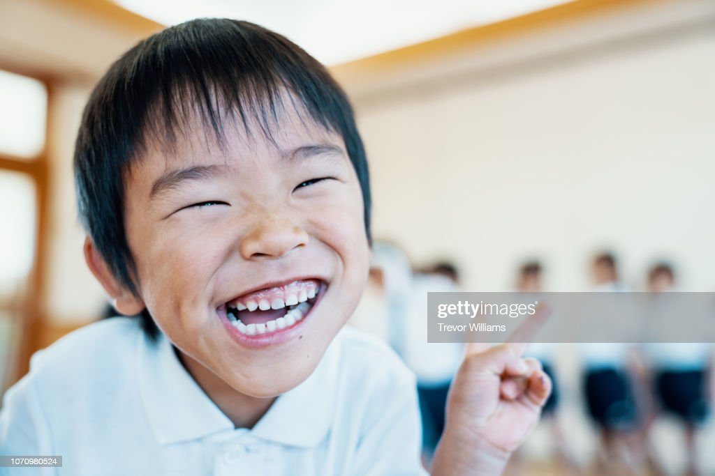 Young boy making a silly face at preschool in Japan : Stock Photo
