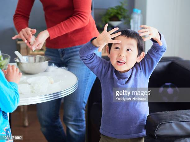 young boy making breakfast with family in home - nori stock pictures, royalty-free photos & images