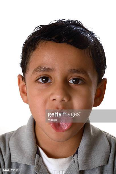 A young boy making faces