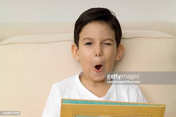 Young boy making faces