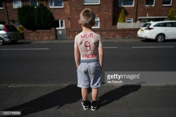 A young boy Mason King pays tribute to Jack Charlton ahead of his funeral cortege which is due to pass through his childhood home town on July 21...