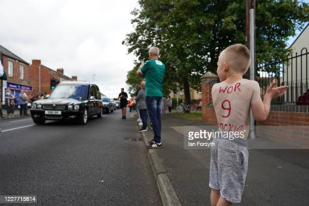 A young boy Mason King pays tribute to Jack Charlton as his funeral cortege passes through his childhood home town on July 21 2020 in Ashington...