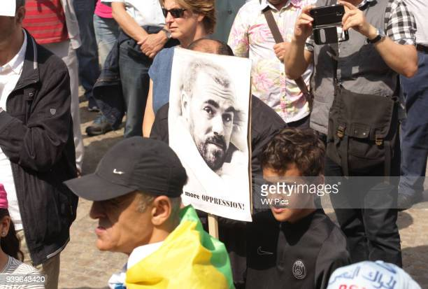Young boy Moroccan hold a poster with the picture of Nasser Zafzafi, leader of the Rif region's protest movement, during a demonstration against...