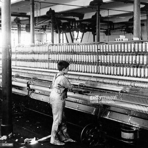 Young boy mule spinning at Jones' Cotton Mill, Manchester, July 1909.