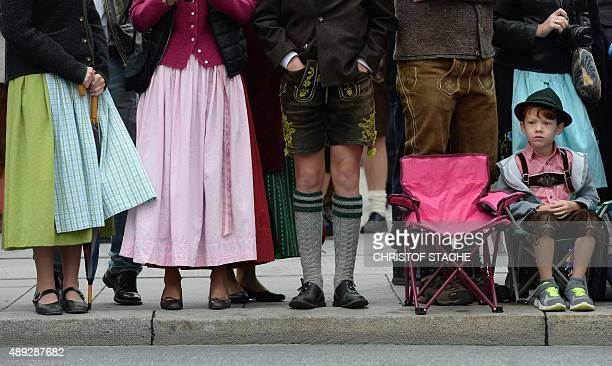 A young boy named Ethan Kramer wearing leatherhose the traditional Bavarian clothes waits for the start of the traditional costume parade at the...