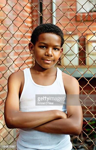 Young boy near fence