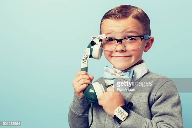 Young Boy Nerd Using Smart Phone and Glasses