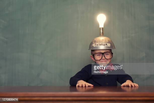 a young boy nerd with an idea - adult imitation stock pictures, royalty-free photos & images