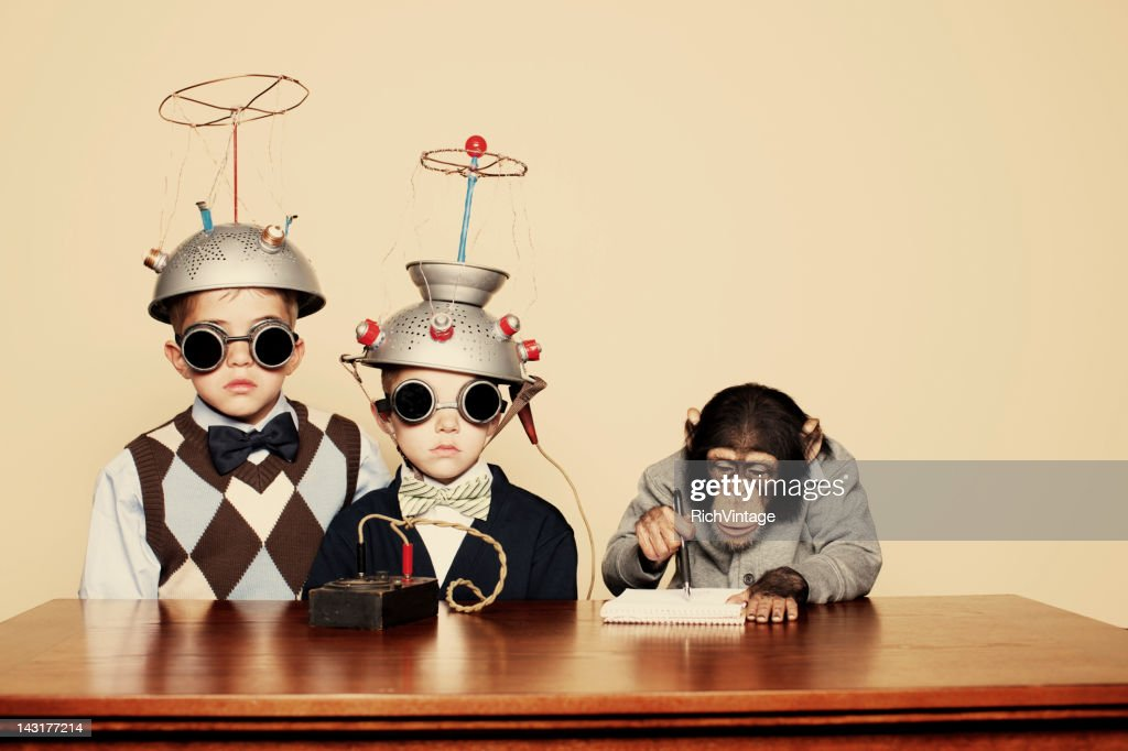 Young Boy Nerds Do Science with Chimpanzee : Stock Photo