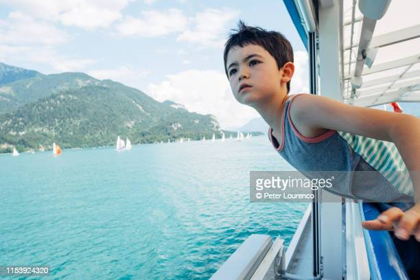 a young boy on a boat - peter lourenco stock-fotos und bilder