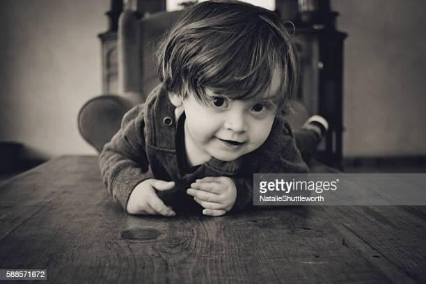 Young Boy on a Coffee Table