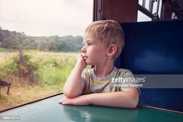 Young boy on a train journey