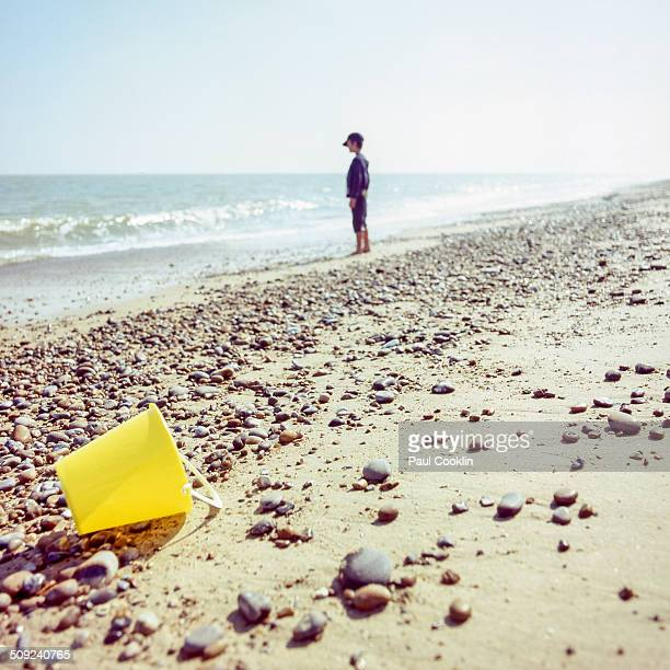 young boy on beach looking out to sea - aldeburgh stock photos and pictures