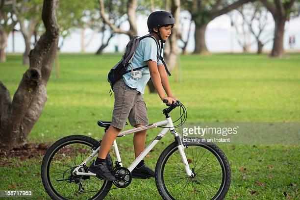 Young boy on bike in park