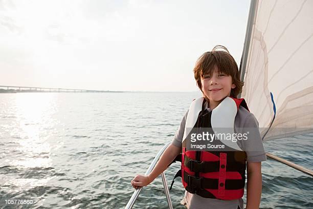 Young boy on board yacht