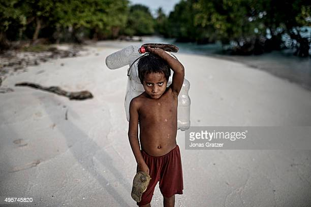 A young boy on his way to fetch fresh water a very scarce commodity in Kiribati The small groundwater nation has been contaminated Most of the...