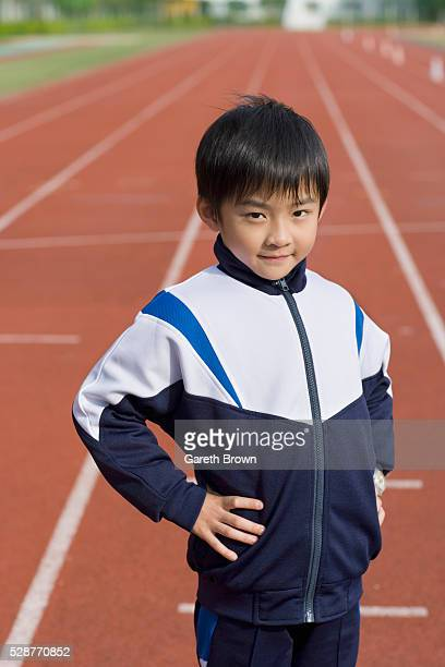 Young Boy on Running Track