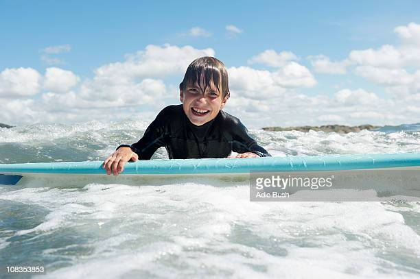 Young boy on surf board in the sea