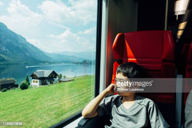 young boy on train in austria - peter lourenco stock pictures, royalty-free photos & images