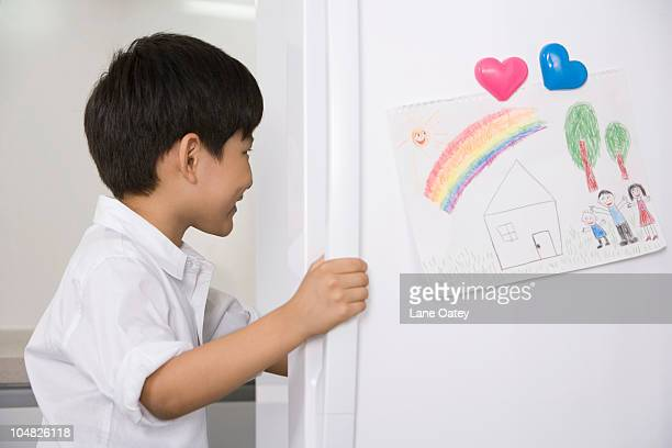 Young boy opening refrigerator