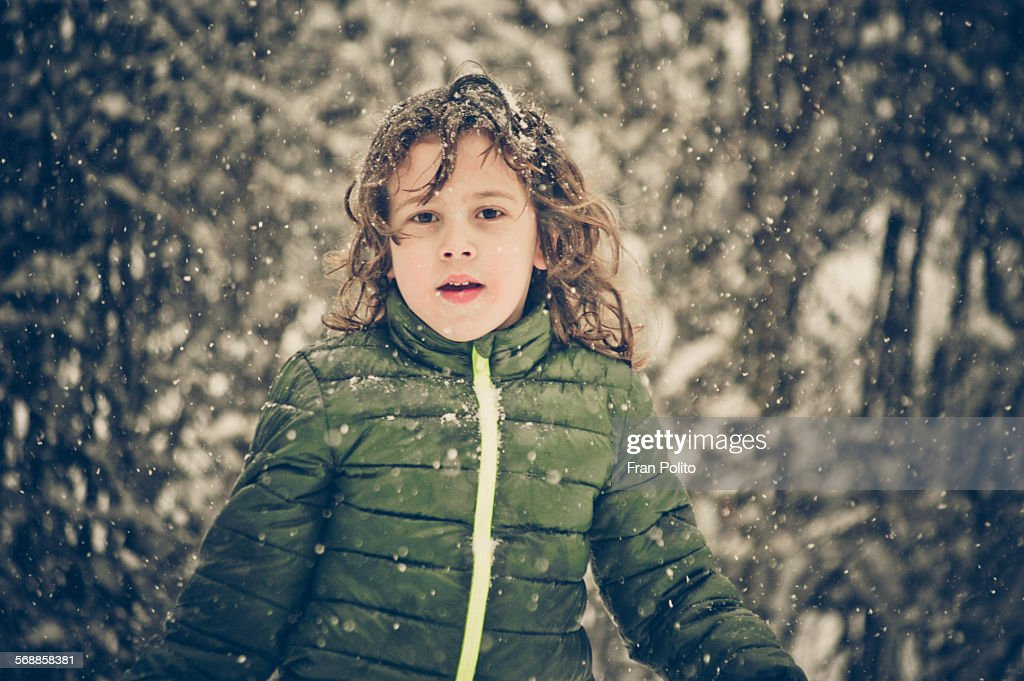Young boy outside in the snow : Stock Photo