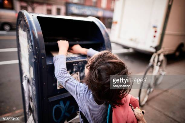 Young Boy Pailing A Letter