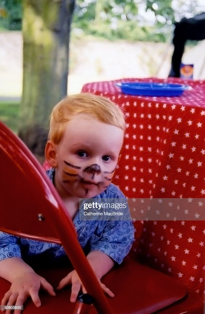 A Young  boy painted of face : Stock Photo