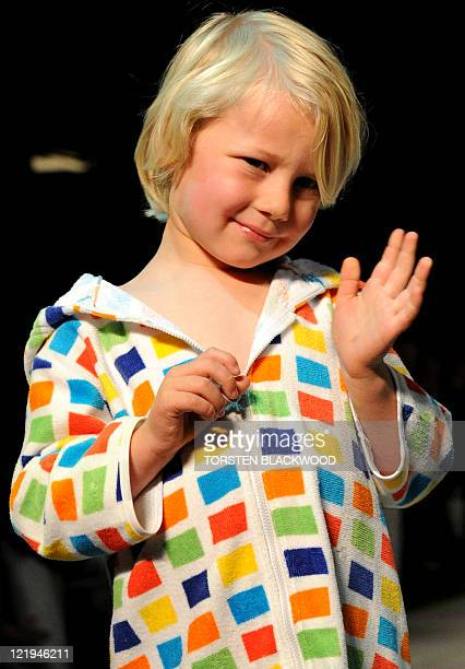 A young boy parades beachwear by the iconic Australian brand 'Speedo' during the Sydney Fashion Festival on August 24 2011 The annual event showcases...