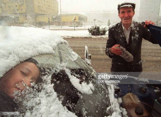 Young boy peers through the snow covered windshield as he's grandfather tries to start their car that stopped on the infamous sniper alley in...