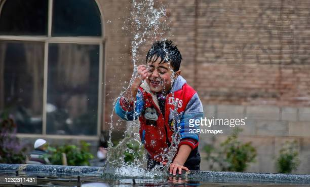 Young boy performs ablution before offering prayers at the Jamia Masjid or Grand Mosque during the first day of Ramadan in Srinagar. Muslims...