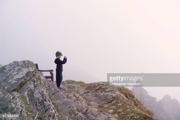 Young boy photographing view