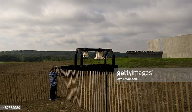 A young boy photographs the ceremonial bells at the Flight 93 National Memorial during the 14th anniversary of the 9/11 attack in Shanksville...