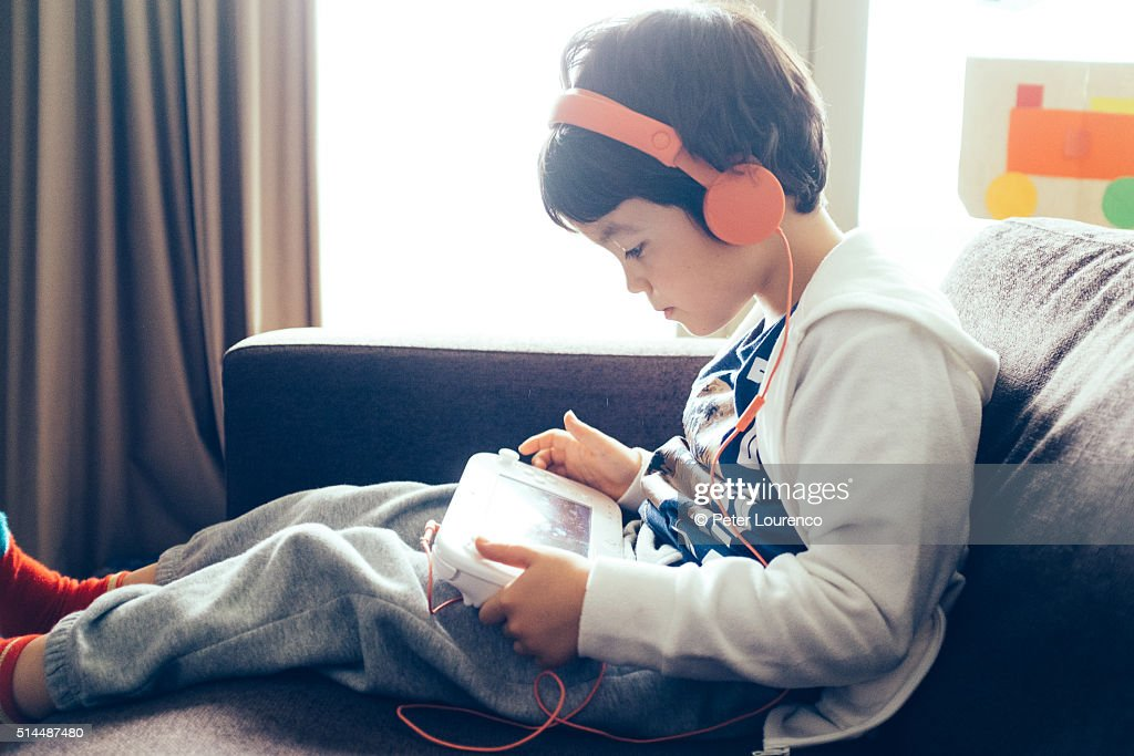 Young boy playing a computer game : Stock Photo