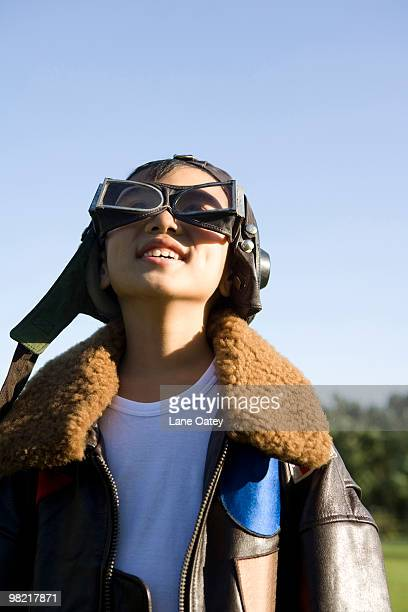 young boy playing airplane pilot - aviation hat stock photos and pictures
