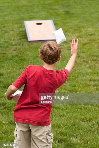 Young boy playing Cornhole