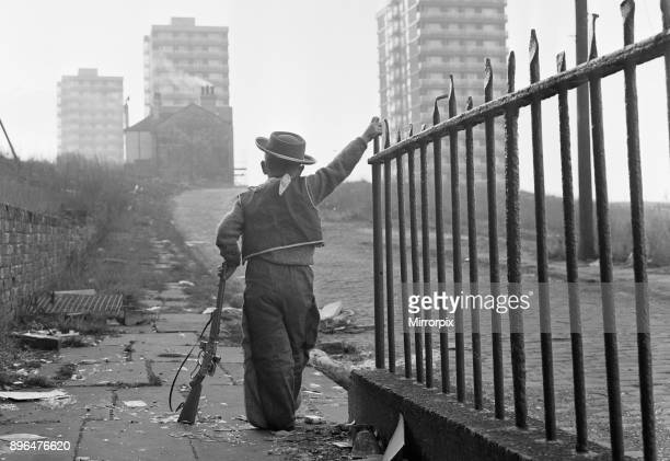 Young boy playing cowboys in Collyhurst Manchester 14th January 1968 His grandfather knew this street when tiny terraced houses stared at each other...