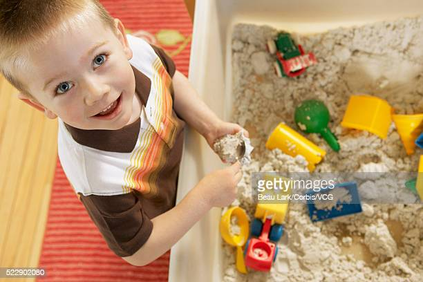 Young boy playing in a sandbox