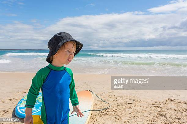Young Boy Playing in Sun Protection Clothes at the Beach