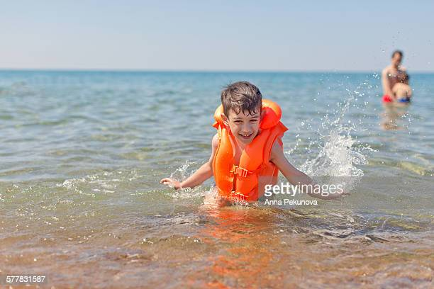 Young boy playing in the sea