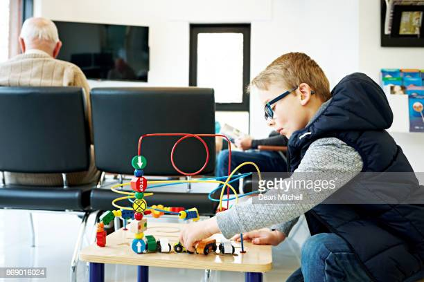 Young boy playing in waiting room at the clinic