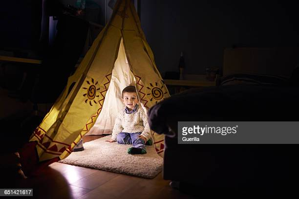 Young Boy Playing Inside Tent Set Up Indoors