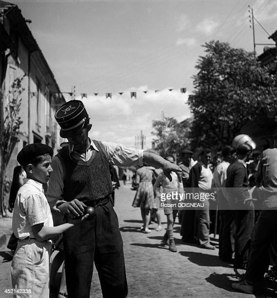 Young boy playing petanque 1945 in Vinon sur Verdon France