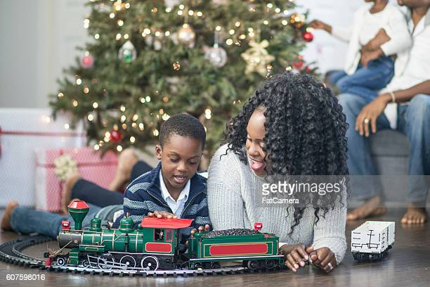Young Boy Playing with a Christmas Train