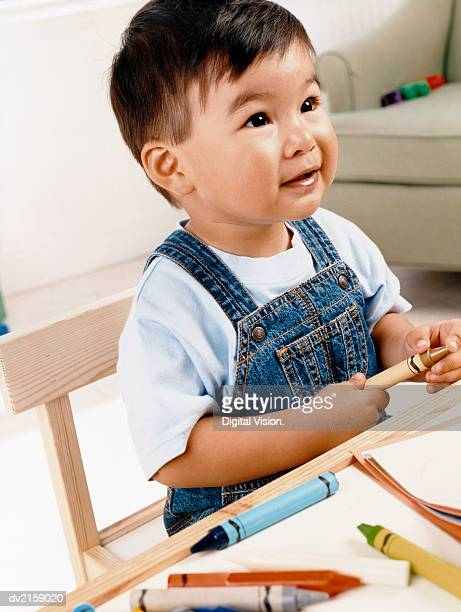 Young Boy Playing with Crayons