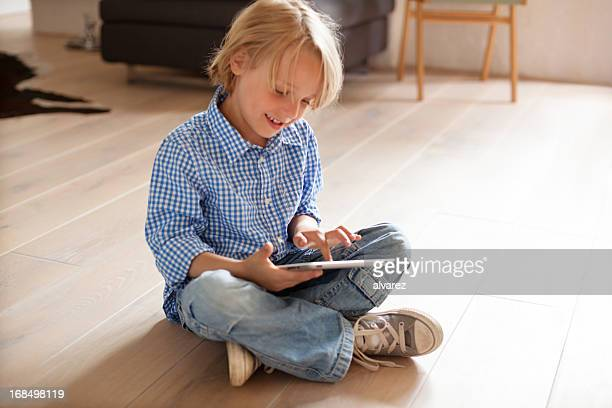 Young boy playing with digital tablet
