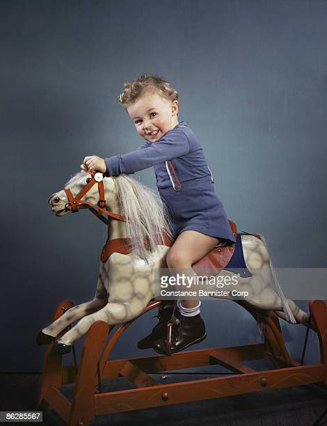 Young boy playing with toy horse