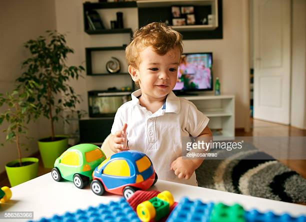 Young boy playing with toys