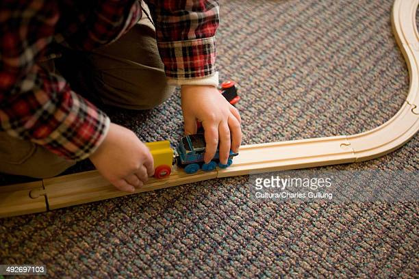 young boy playing with train set - 模型の汽車 ストックフォトと画像